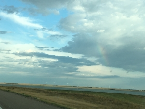 rainbow and wind turbines